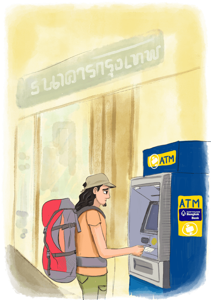 Voyageur qui retire de l'argent à un distributeur dans un pays étranger