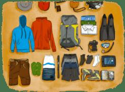 Contenu de l'équipement d'un sac pour un tour du monde étalé au sol